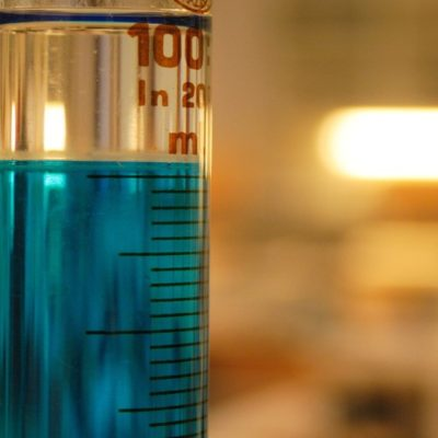 A test tube filled with chemicals in a lab