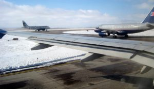 A view from a passenger jet of an icy runway